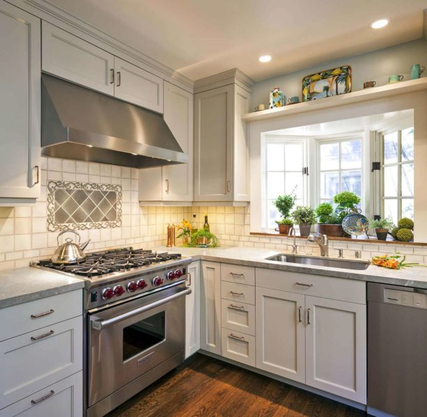elegant traditional kitchen with bay windows over an undermount sink