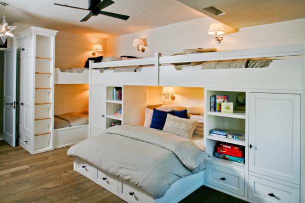 kid's room in beach style with a wall bed in the middle