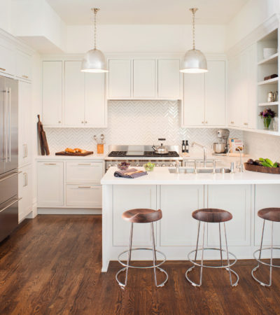 kitchen peninsula with caesarstone countertops and modern low back stools seating