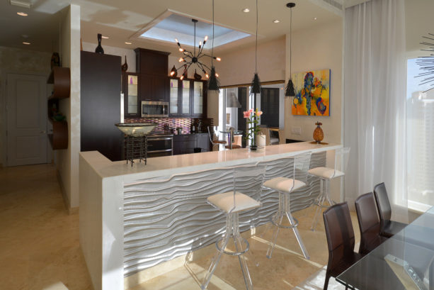 kitchen peninsula with waterfall marble countertop with high back stools seating