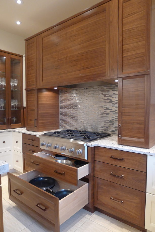 metallic backsplash behind stove combined with granite countertops