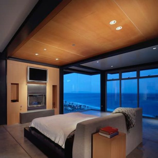 modern room with a wooden frame bed in the middle