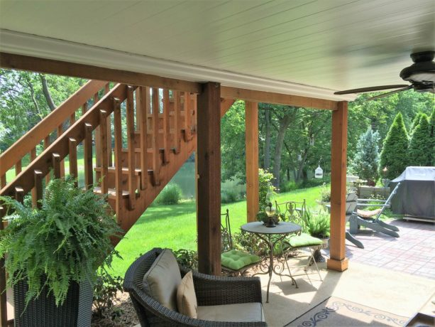 patio idea under the deck with white ceiling