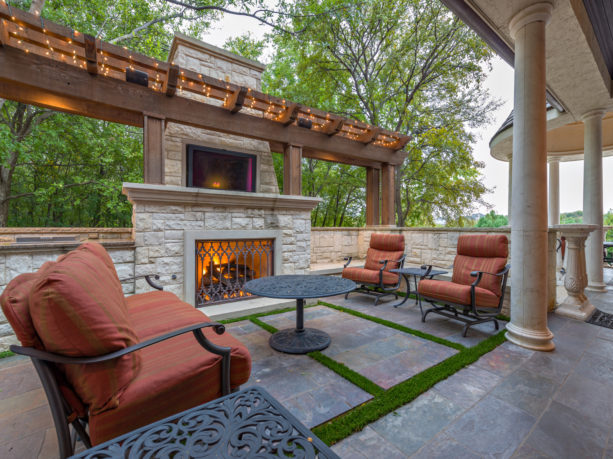pavilion with travertine decking and outdoor fireplace completed with 42 inch tv