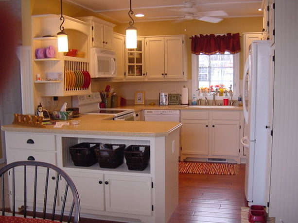 super tiny u-shaped kitchen with a peninsula and white appliances