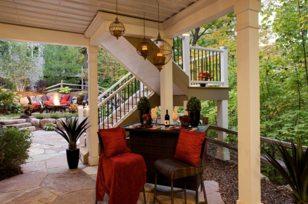 traditional stone patio idea with sheet covered under deck ceiling