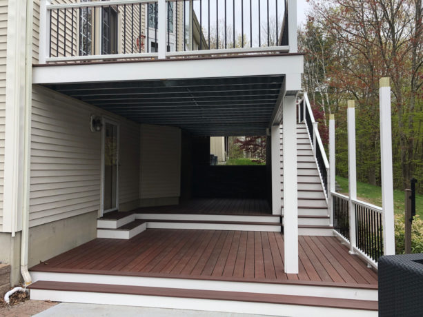 two-story deck idea with a ceiling over the first story underneath