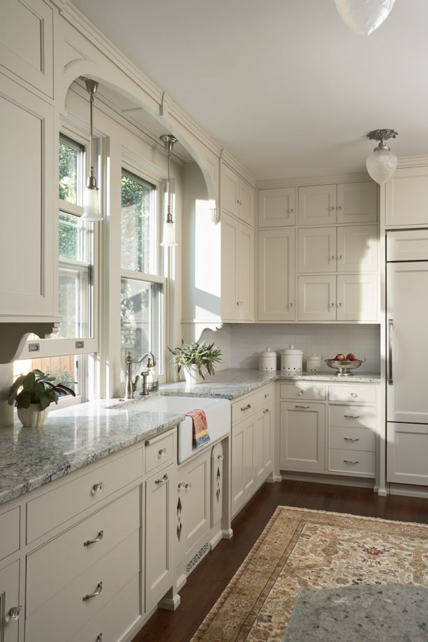 victorian kitchen with double hung windows over a farmhouse sink