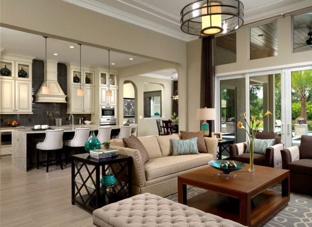 black and white pullman kitchen and beige transitional living room combo