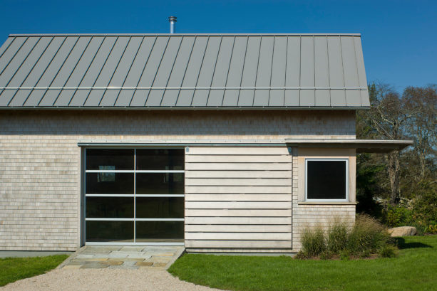 combination of metal, glass and wood side sliding garage doors