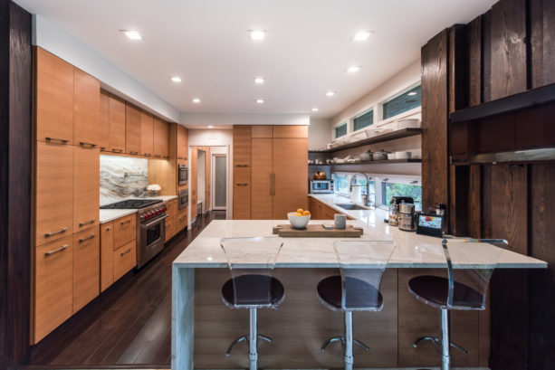 dark brown kitchen color with light brown flat-panel cabinets and white countertops combination for natural look