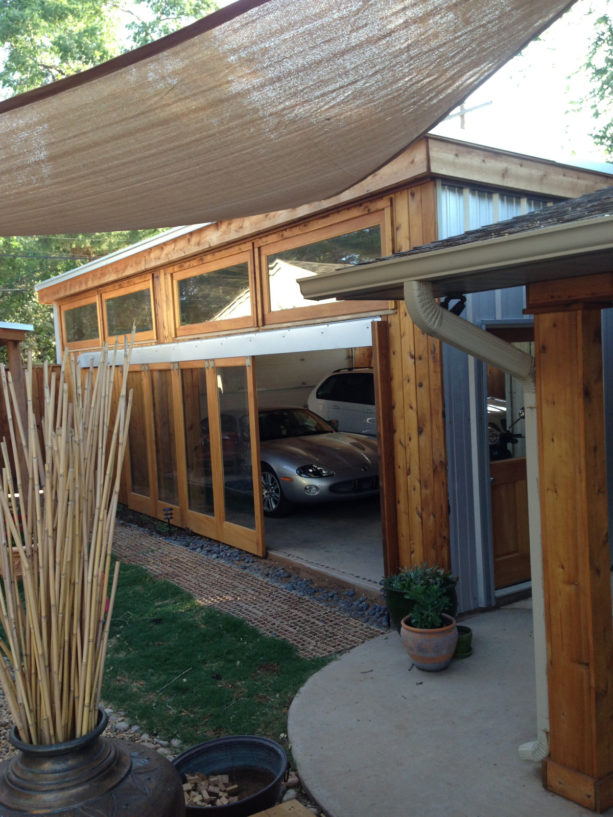 full glass panel side sliding door in a rustic garage