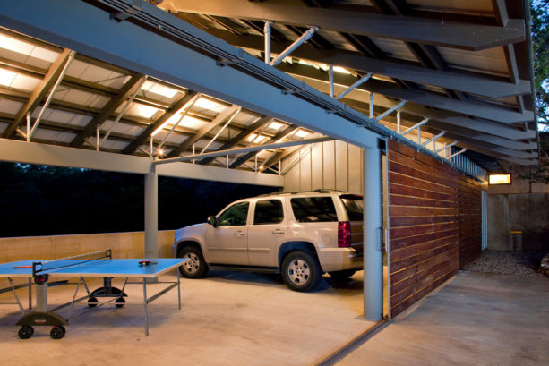 medium tone wood side sliding door in an industrial garage