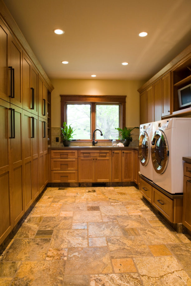 travertine tile laundry room floor to give a soft neutral tone