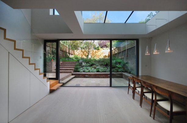 trendy bi-fold glass door option for a contemporary walkout basement