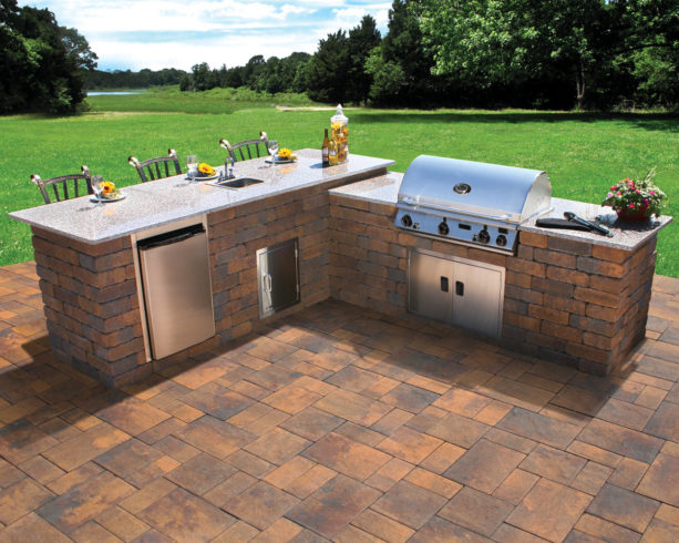 uncovered l-shaped outdoor kitchen and bar with polished granite countertops