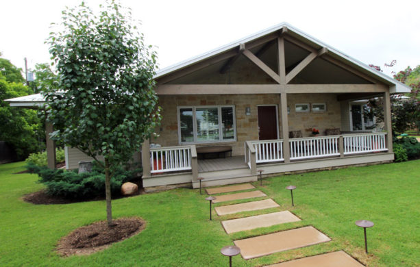 50's ranch style home with a spacious contemporary front porch