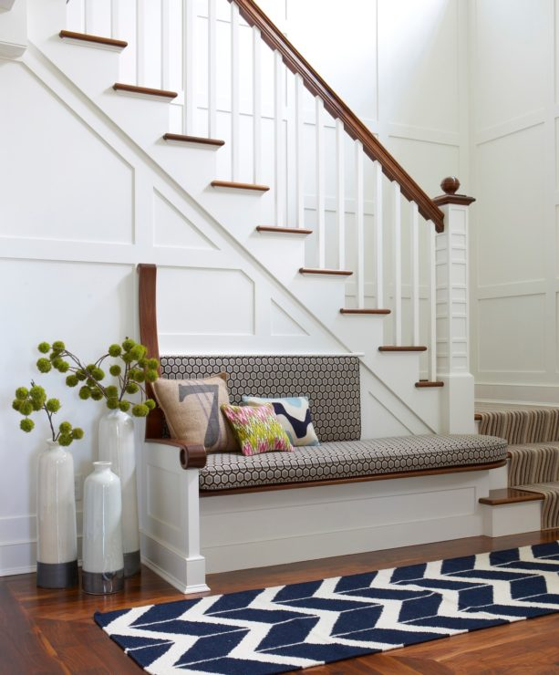 beach style small entryway with polished wood flooring