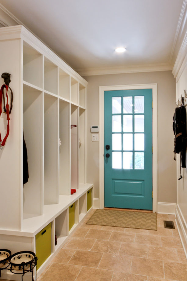 classic small entryway with travertine flooring