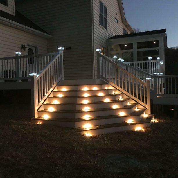 combination of solar post caps and outdoor stair lighting in a deck