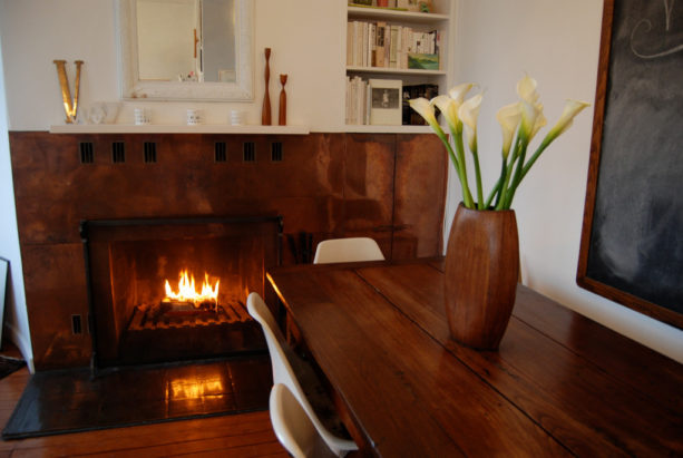 copper mid-century modern fireplace with crisp white mantel