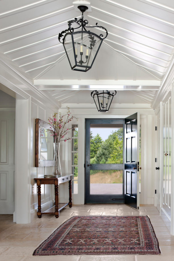 country style small entryway with beige tile flooring