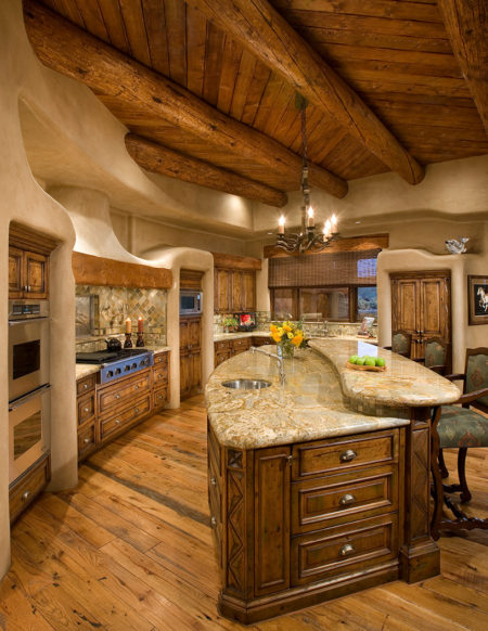 curvy two-level kitchen island made of dark-toned wood