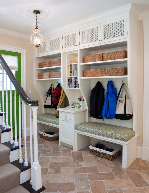 elegant foyer as a small entryway with travertine tile flooring