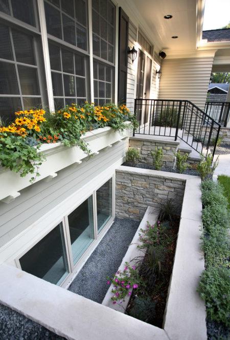 extra wide stone basement window well