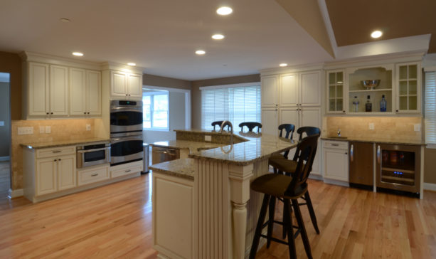 l-shaped two-level kitchen island with granite countertops