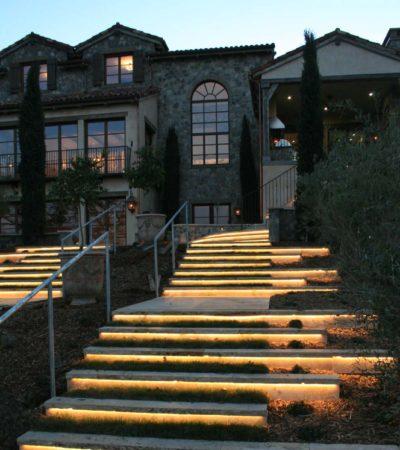 led outdoor lighting underneath the walnut travertine stair
