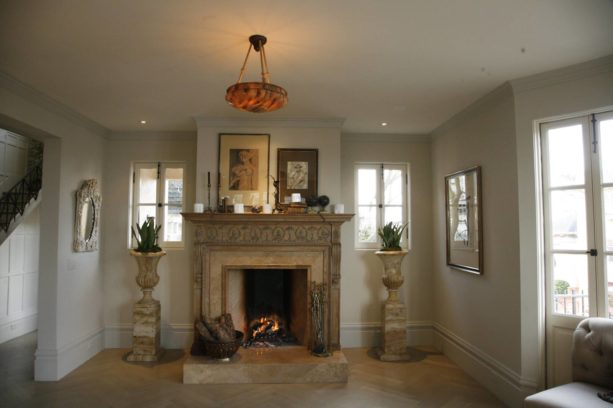 marble mid-century modern fireplace with golden-colored mantel
