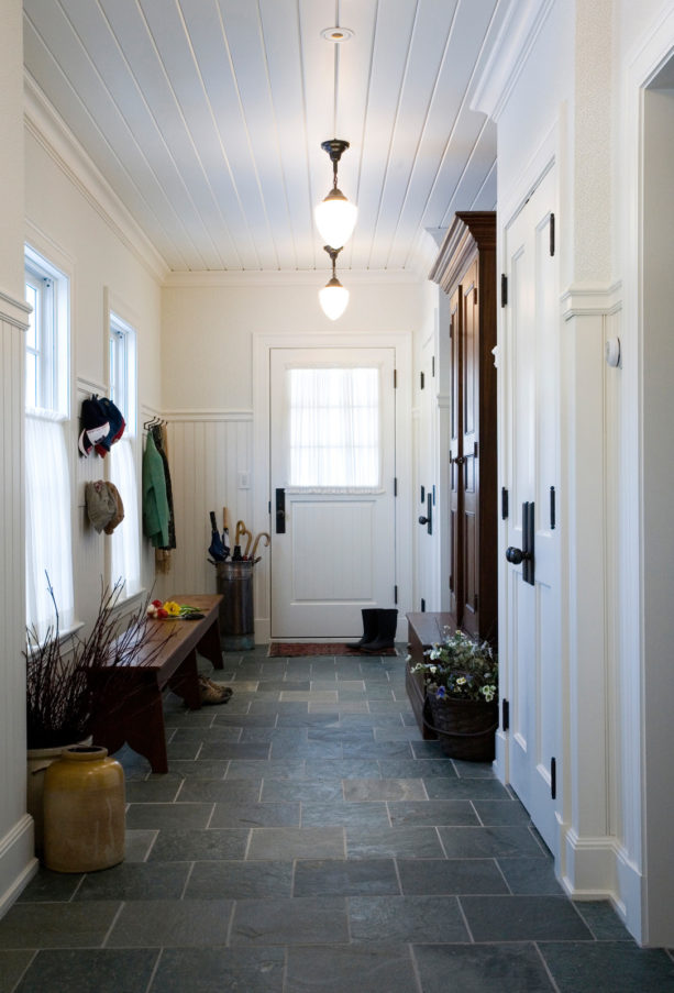 mid-century style small entryway with gray slate tile flooring