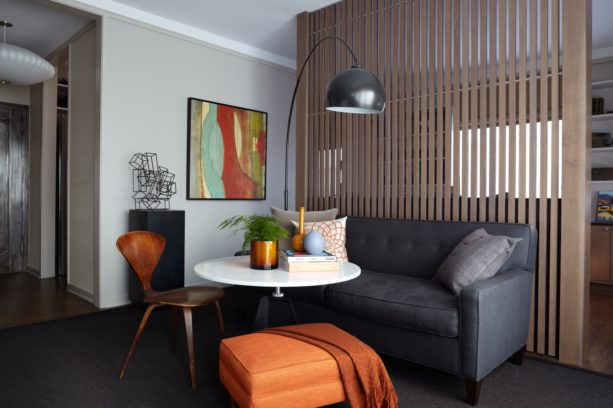 modern living room with vertical wood slat wall as a partition