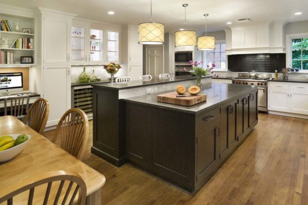 solid black two-level kitchen island as meal prep and eating space