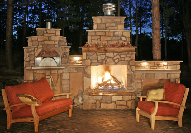 stone veneer fireplace with a traditional-style pizza oven