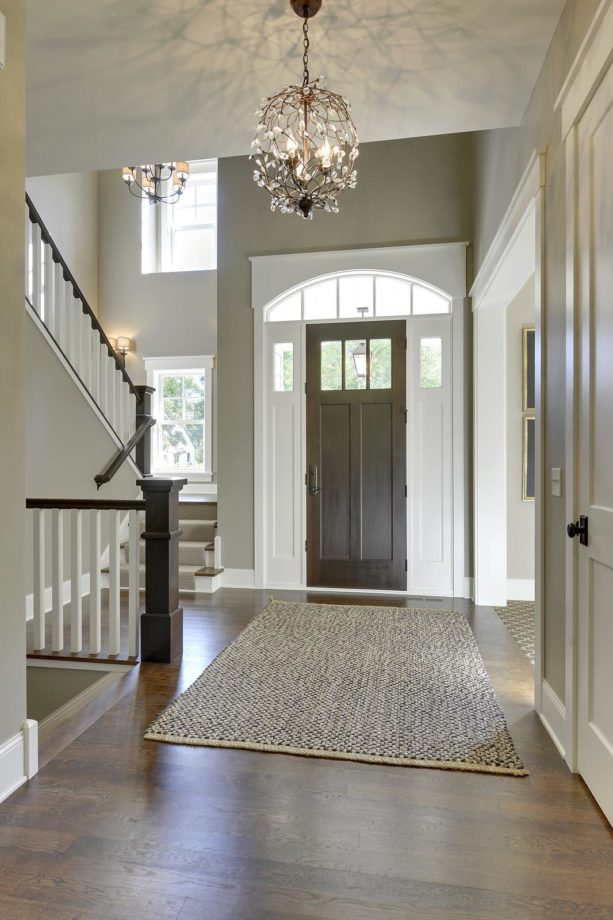 traditional foyer entryway with white oak flooring