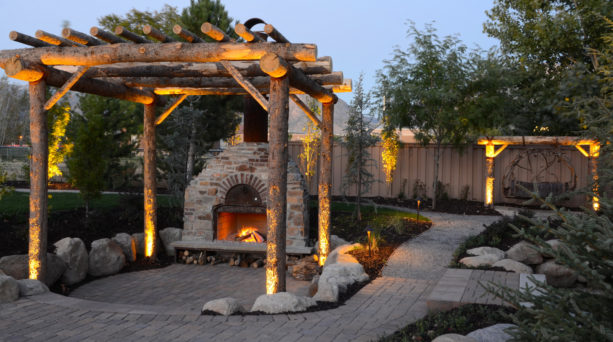 traditional patio with trellis, an outdoor fireplace, and a custom pizza oven