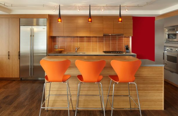 two-level kitchen island combined with caesar stone and light tone wood countertops