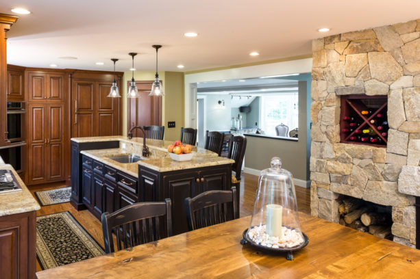 u-shaped upper two-level kitchen island painted in black color