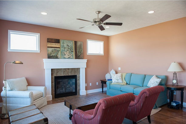 orange starfish wall color in an enclosed living room with a tiffany blue sofa