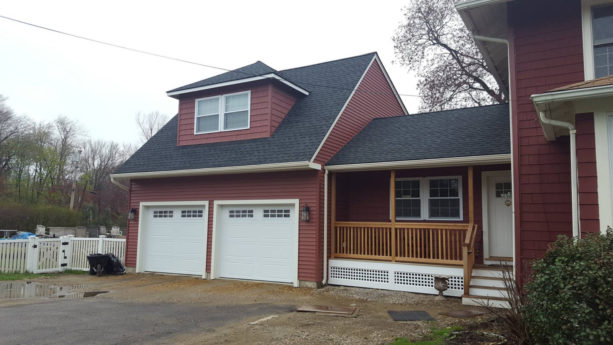 two-car garage with a small bonus room above